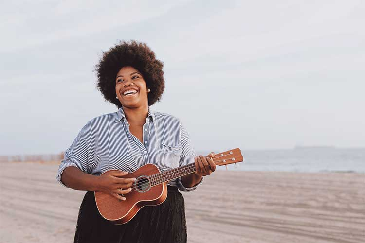 Black woman playing an instrument