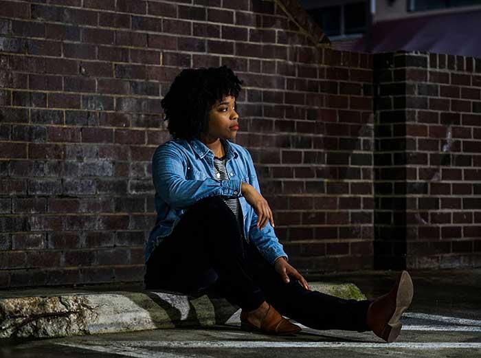 black women sitting on step