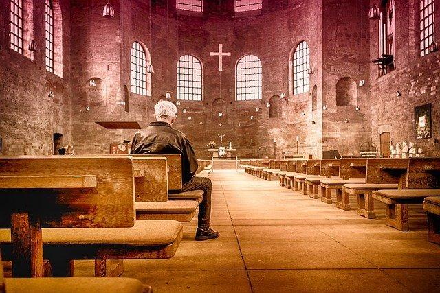 Man praying alone in a church